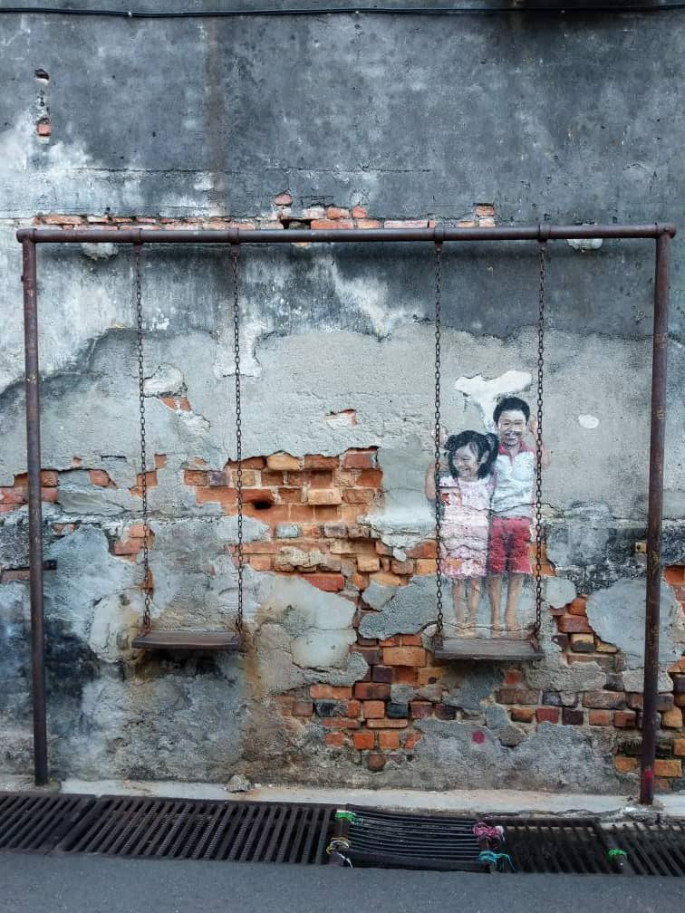 Penang Street Art Brother Sister on a Swing.jpeg